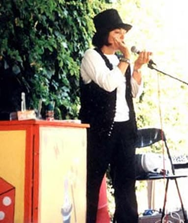Magic Valery sings on a stage